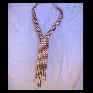 Long silver chain with diamonds